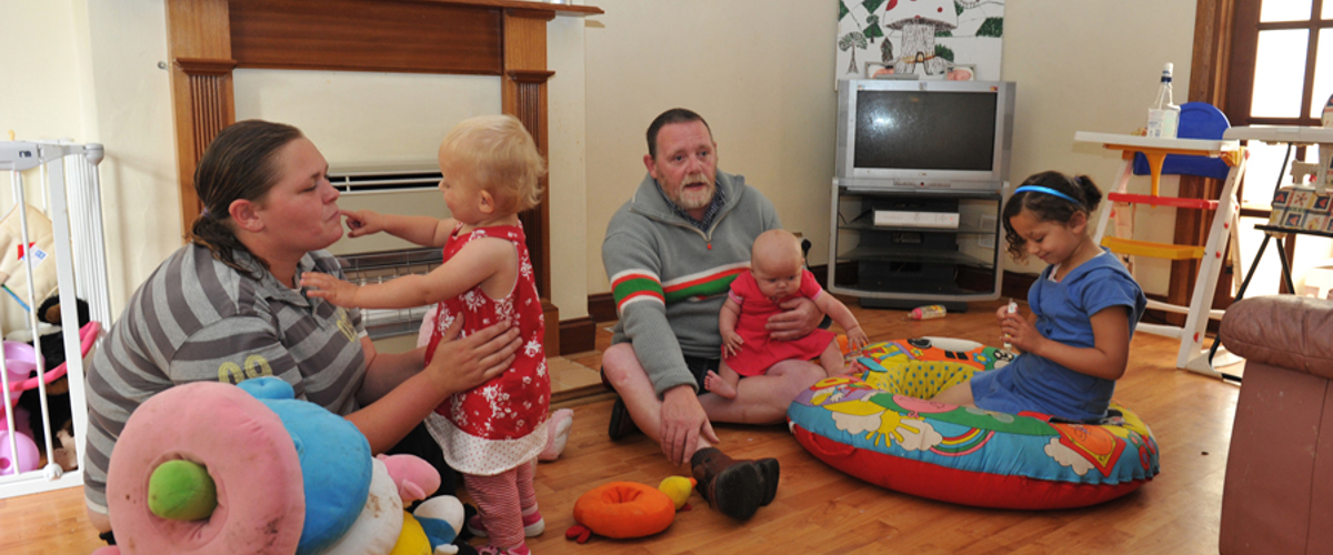 Family at home with a Home-Start volunteer