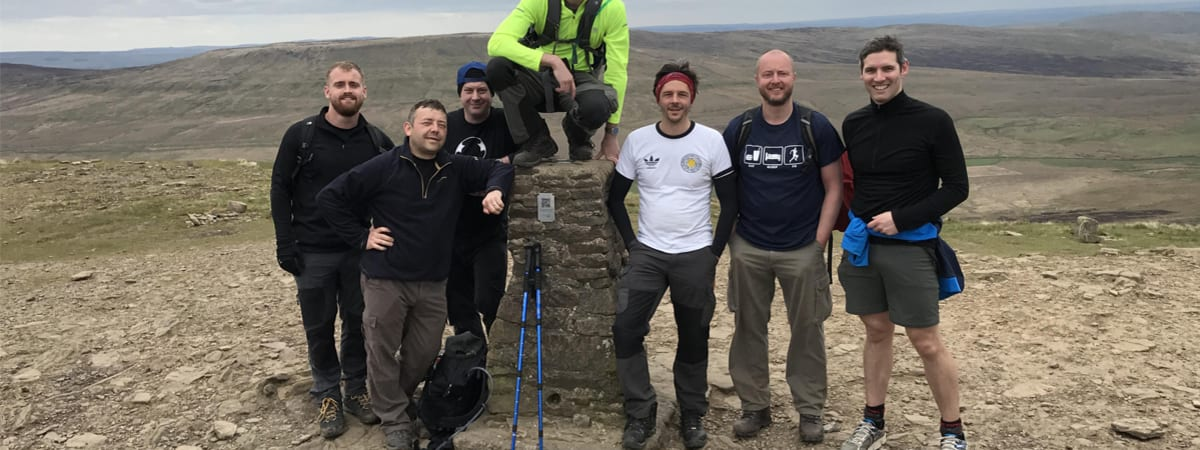 Team from Dunelm at a summit on the Yorkshire Three Peak Challenge