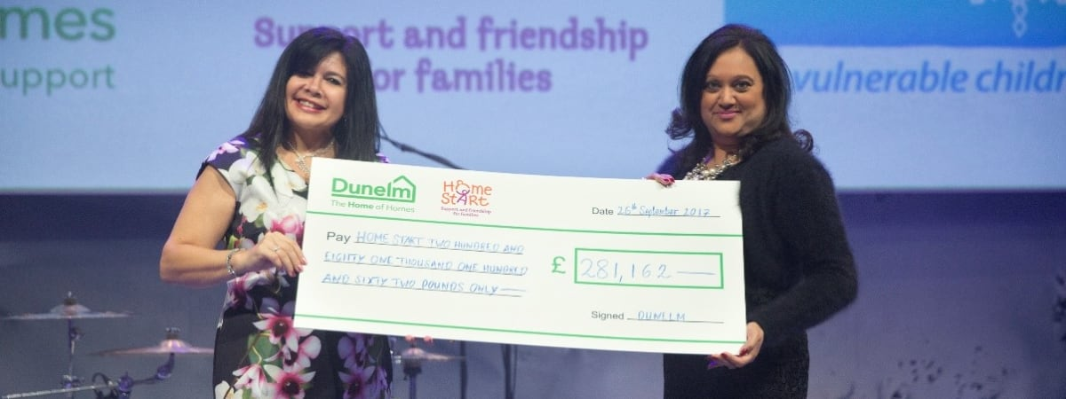 Anita Frith and Stephanie Henderson-Barrett accepting a cheque from Dunelm to Home-Start UK