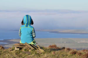 child looking out to see in Orkney